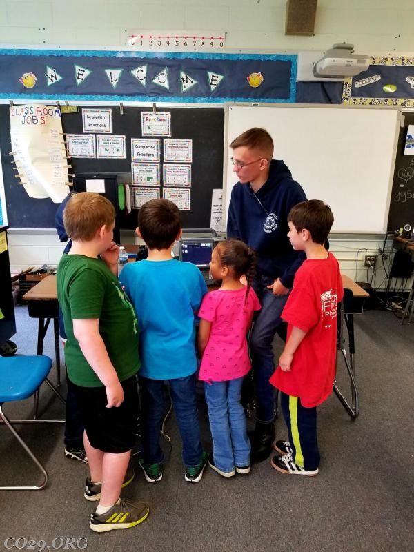 J. Peters showing students how to use a monitor.