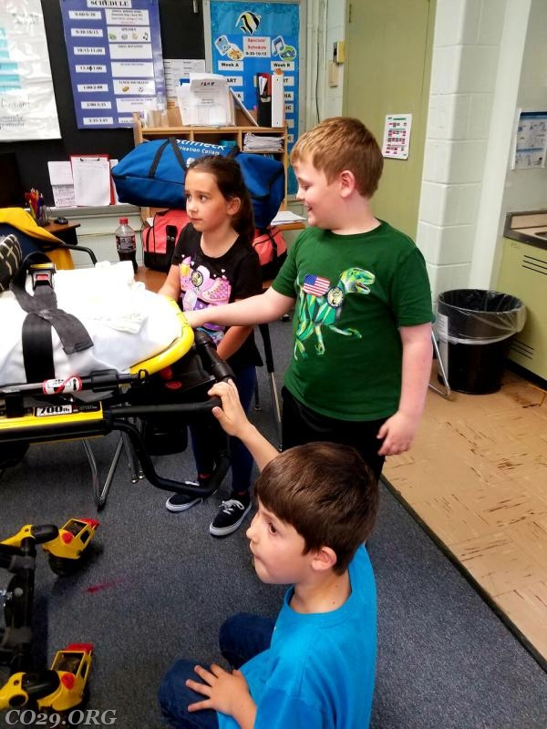 Students went hands on learning how to use a power stretcher.